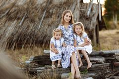 Mother and two daughter having fun in the park. Beauty nature scene with family outdoor lifestyle. Happy family concept royalty free stock images