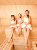 Mother with two daughter relaxing at steam bath Stock Photo
