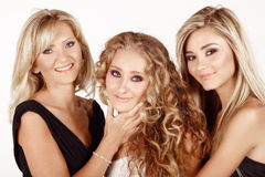 Mother and two daughters. Two generations of women: mother in her 40s with a beautiful teenage and young adult daughters with different hairstyles. Real life Stock Photography