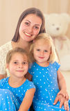 Mother with two daughters. Royalty Free Stock Image