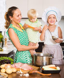 Mother with two daughters cooking Royalty Free Stock Photo