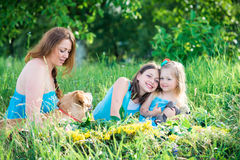 Mother, two daughters and dog Royalty Free Stock Photos