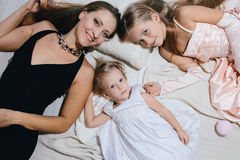 Mother and two daughters enjoy life. happy family. In festive dresses Stock Photography