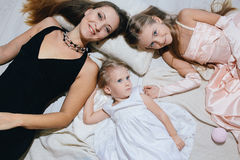 Mother and two daughters enjoy life. happy family. In festive dresses Royalty Free Stock Photo