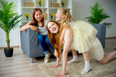 Mother and two daughters fooling around Stock Photography