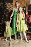 Mother with two daughters in a green dress Royalty Free Stock Photo