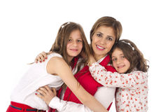 Mother and two daughters hugging Royalty Free Stock Image