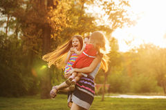 Mother and two daughters hugging Royalty Free Stock Photos