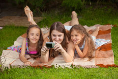 Mother and two daughters making self photo Royalty Free Stock Images