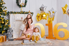 Mother and two daughters. New Year 2016. Royalty Free Stock Photos
