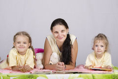 Mother and two daughters are reading books Royalty Free Stock Images