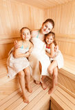 Mother with two daughters relaxing at sauna Royalty Free Stock Images