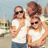 Mother and two daughters standing on the road at the day time. Royalty Free Stock Photography