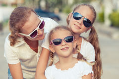 Mother and two daughters standing on the road at the day time. Stock Photography