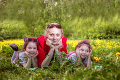 Mother with two daughters in the summer park Royalty Free Stock Image
