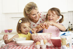 Mother And Two Girls Baking In Kitchen Royalty Free Stock Photography