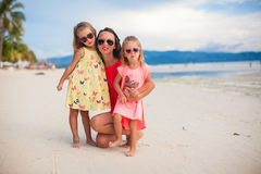 Mother and two her kids at exotic beach on sunset Stock Photography