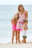 Mother with two kid on beach background Stock Photos