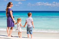 Mother and two kids at beach Royalty Free Stock Photos