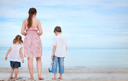 Mother and two kids on beach Stock Photos