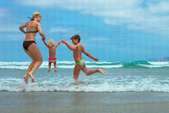 Mother and two kids  on beach Royalty Free Stock Photo