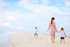 Mother and two kids on beach Royalty Free Stock Photography