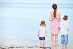 Mother and two kids on a beach Royalty Free Stock Photo