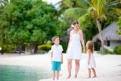 Mother and two kids at beach Stock Image