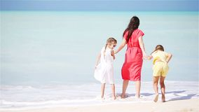 Mother with two kids enjoy beach vacation stock footage