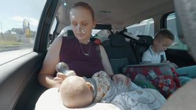 Mother with two kids going on holiday by car stock video footage
