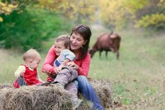 Mother with two kids on nature Royalty Free Stock Images