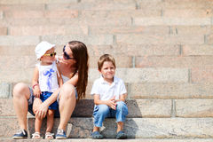 Mother and two kids outdoors Royalty Free Stock Images