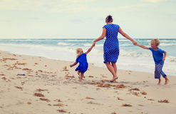 Mother and two kids play on beach Royalty Free Stock Images