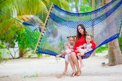 Mother and two kids at summer vacation in exotic resort Stock Photos