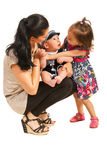 Mother with two kids talking Stock Image