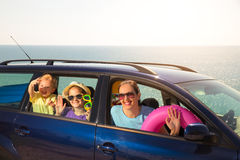 Mother with two kids travel by car on sea vacation Stock Images