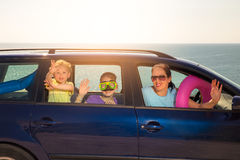 Mother with two kids travel by car on sea vacation Royalty Free Stock Photography