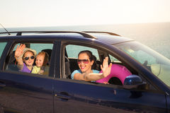 Mother with two kids travel by car on sea vacation Stock Photos