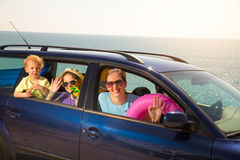 Mother with two kids travel by car on sea vacation Stock Photo