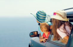 Mother with two kids travel by car on sea vacation Royalty Free Stock Images