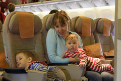 Mother with two kids travel by plane Royalty Free Stock Photo