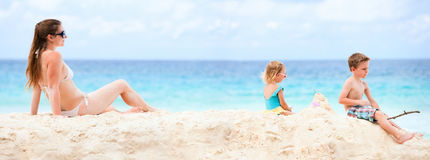 Mother and two kids at tropical beach Stock Photos