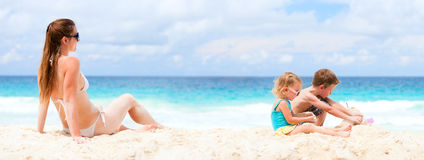 Mother and two kids at tropical beach Stock Photography