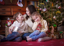 Mother with two kids under Christmas with lantern Royalty Free Stock Photos