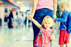Mother and two kids walking in the airport Royalty Free Stock Images
