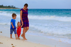 Mother and two kids walking on the beach Royalty Free Stock Photo