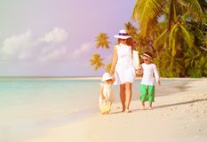 Mother and two kids walking on tropical beach Stock Photography