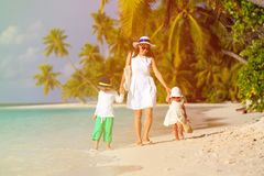 Mother and two kids walking on tropical beach Royalty Free Stock Photography