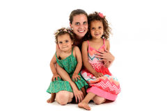 Mother and two mulatto daughter from interracial marriage or ado stock image