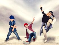 Mother and two son dance hip-hop.Urban lifestyle. Hip-hop generation. Hip-hop generation.Mother and two son dance hip-hop.Urban lifestyle royalty free stock photography